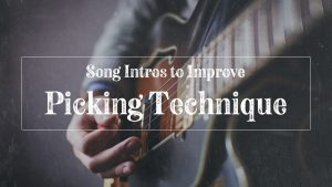 Guy picking guitar strings to improve picking technique
