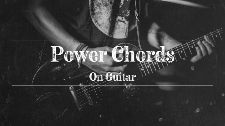 Guy playing power chords on guitar