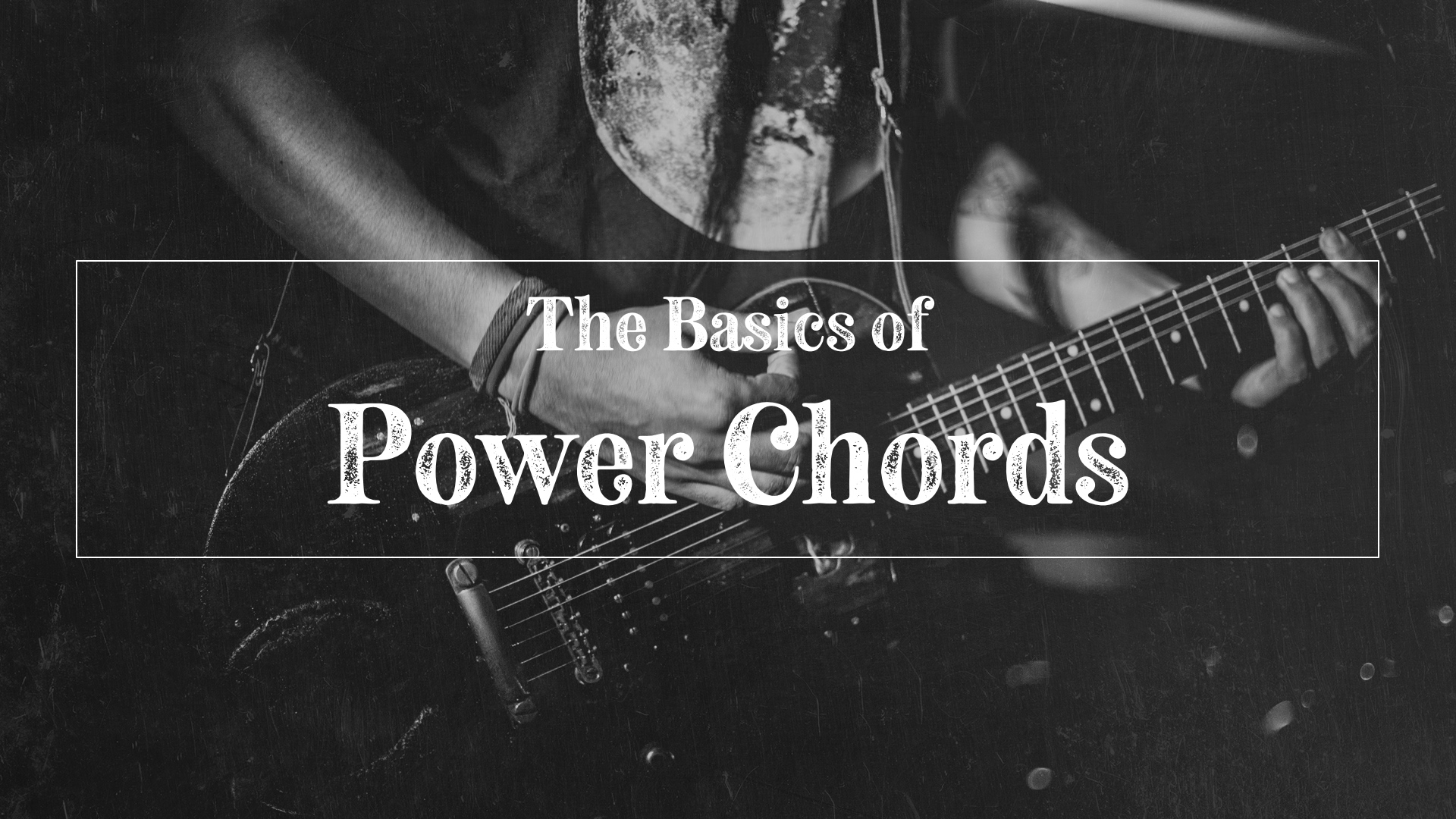 Guitarist playing basic power chords