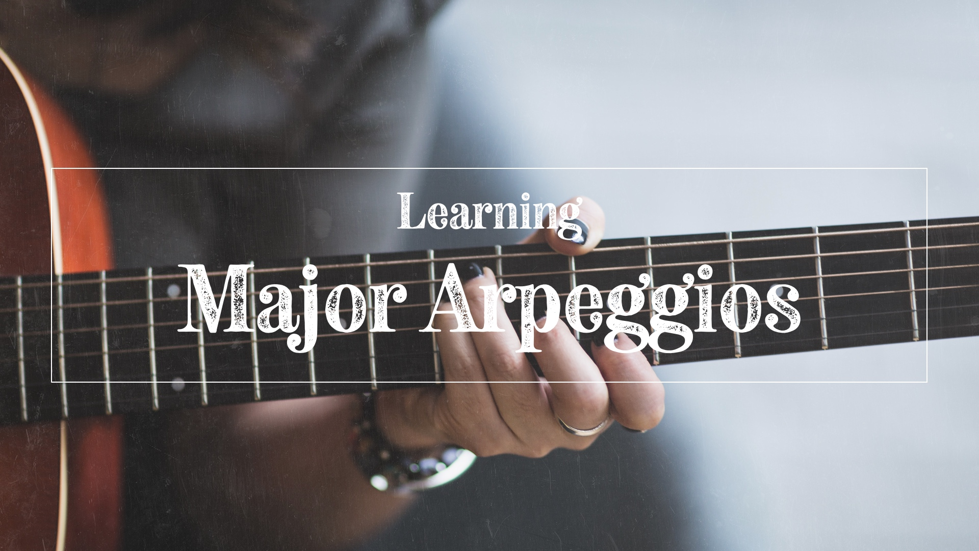 Guitarist playing major arpeggios