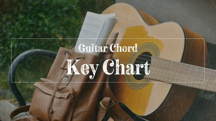 Guitar laying with guitar chord key chart in messenger bag