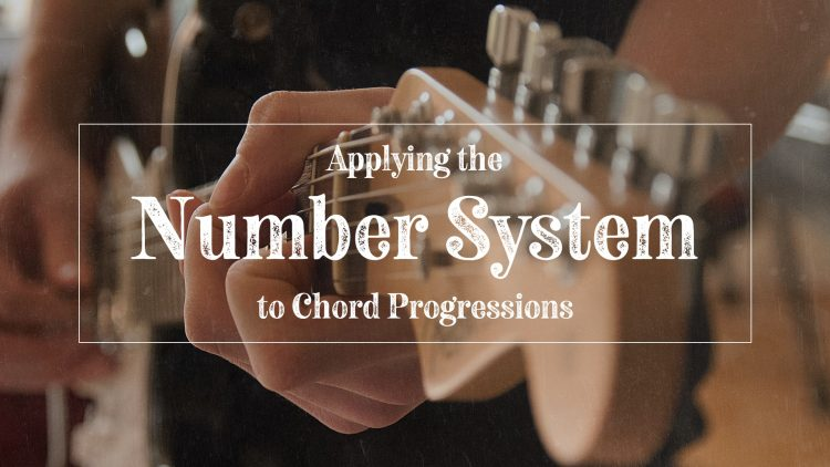 Guitar player playing guitar chords by number